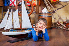 Boy with ship Stock Photography