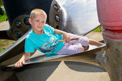 Boy on the ship's propeller Royalty Free Stock Photo