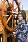 Boy at ships wheel Royalty Free Stock Images
