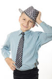 Boy in a shirt, hat in hand. Boy in shirt and tie white background Stock Photos