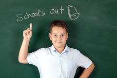 Boy in a shirt with school boards Royalty Free Stock Images
