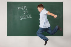 Boy in a shirt with school boards Stock Images