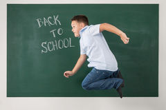 Boy in a shirt with school boards Stock Image