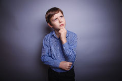Boy in shirt thinking Stock Photos