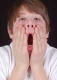 Boy in shock. Surprise surprise, this boy can't believe his eyes!  Oh my gosh, what's got his face so astonished Stock Images