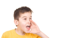 Boy shooting. Young boy gives a yell - isolated stock photography