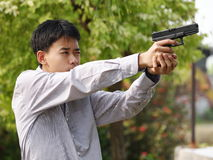 Boy shooting air soft ball bullet gun Stock Photos
