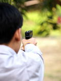 Boy shooting air soft ball bullet gun Royalty Free Stock Image