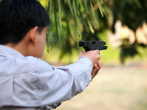 Boy shooting air soft ball bullet gun Royalty Free Stock Images