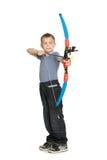 Boy shooting a bow. Sports for children stock photos