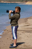 Boy shooting with camera. Royalty Free Stock Photography
