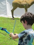 Boy Shooting Compound Bow Royalty Free Stock Image