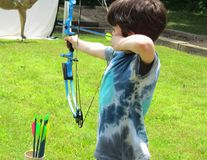 Boy Shooting Compound bow Stock Image