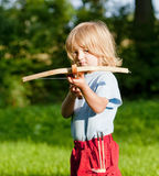 Boy shooting with crossbow Stock Photography