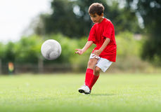 Boy Shooting at Goal Stock Photography
