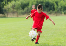 Boy Shooting at Goal Royalty Free Stock Photography