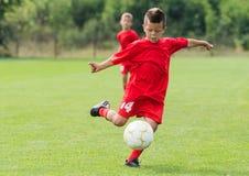Boy Shooting at Goal. Little Boy Shooting at Goal royalty free stock photos