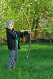 Boy shooting with a hand made bow and arrow. Archery Stock Photos