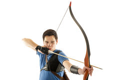 Boy shooting with a longbow Stock Photos