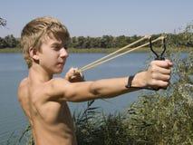 Boy Shoots A Slingshot Stock Photos