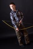 Boy shoots a bow Stock Image
