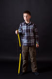 Boy shoots a bow. On a black background Stock Photo