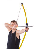 Boy shoots a bow Stock Photography