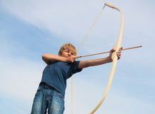 Boy shoots a bow at a target Royalty Free Stock Images