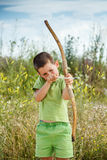 Boy shoots a bow. At a target, in the open air Stock Photos