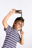 Boy shoots a slingshot Royalty Free Stock Photo