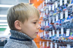 Boy in shop Royalty Free Stock Photography