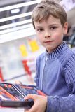 Boy in shop with  tool set in hands Royalty Free Stock Photos