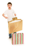 Boy with shopping bag Stock Photo