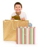 Boy with shopping bag Stock Photos