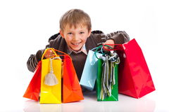 Boy with Shopping Bags Stock Photos