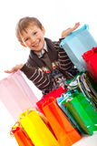 Boy with Shopping Bags Royalty Free Stock Images