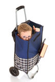 Boy in shopping cart Stock Photo