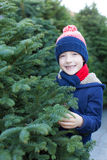 Boy shopping for christmas tree Royalty Free Stock Photography