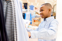 Boy shopping for clothes Stock Photos