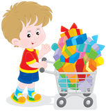 Boy with a shopping trolley of gifts. Little buyer going with a supermarket trolley overfilled with colorful boxes stock illustration