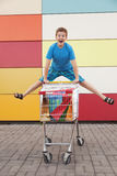 Boy  with shopping trolley Royalty Free Stock Image