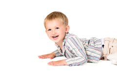 Boy shot in the studio on a white background laying smiling Stock Images