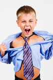 The boy shouted. The boy cries and tears his shirt Stock Photography