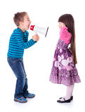 Boy shouting at girl with megaphone. Little boy shouting at girl with megaphone Royalty Free Stock Photos