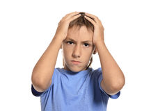 Boy shouting and holding his head Royalty Free Stock Photos