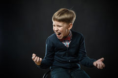 Boy shouting Stock Images