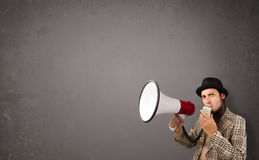 Boy shouting into megaphone on copy space background Royalty Free Stock Images