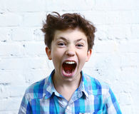 Boy shouting yelling close up portrait Stock Photo