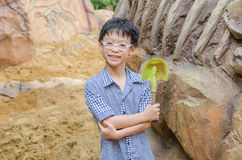 Boy with shovel for digging in sandbox. Young Asian boy with shovel for digging in sandbox Stock Images