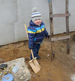 Boy with shovel Stock Images